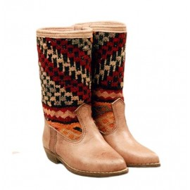 Leather boot and kilim